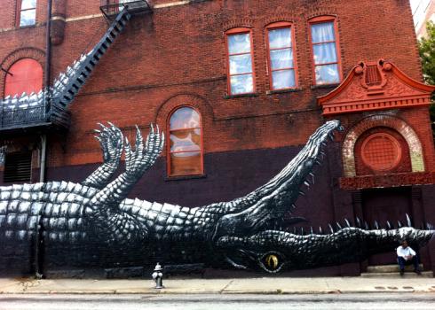 Since 1929, 209 Mitchell Street has been home to Friedman's Shoes. In 2011, Living Walls added a giant alligator to the exterior. Alligator on the inside has been a staple for decades.
